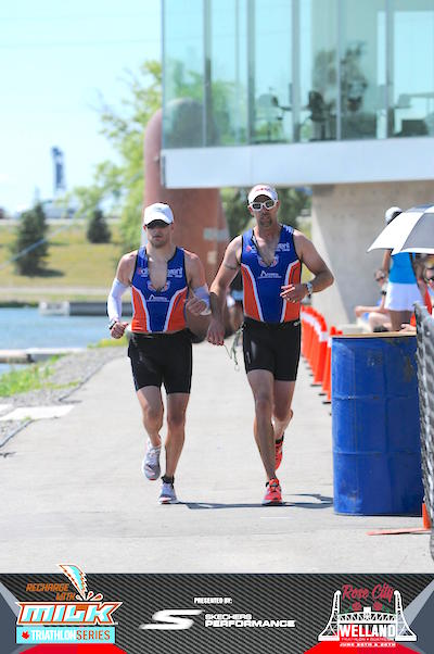 Ryan Van Praet and Syd Trefiak on the run course at the Welland Long Course Triathlon.